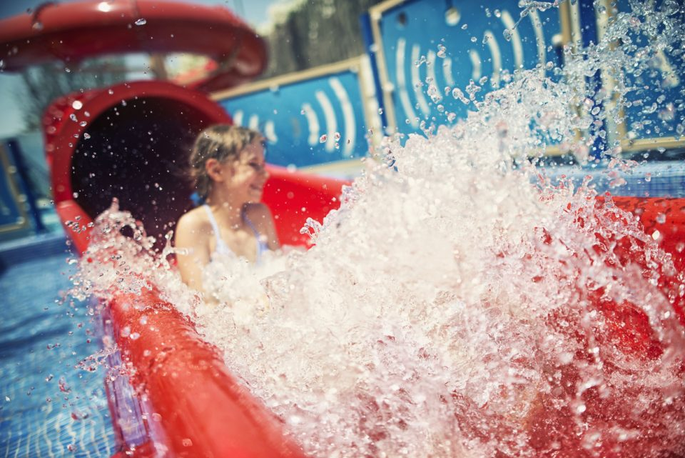 Little girl on a water slide at Alabama Splash Adventure