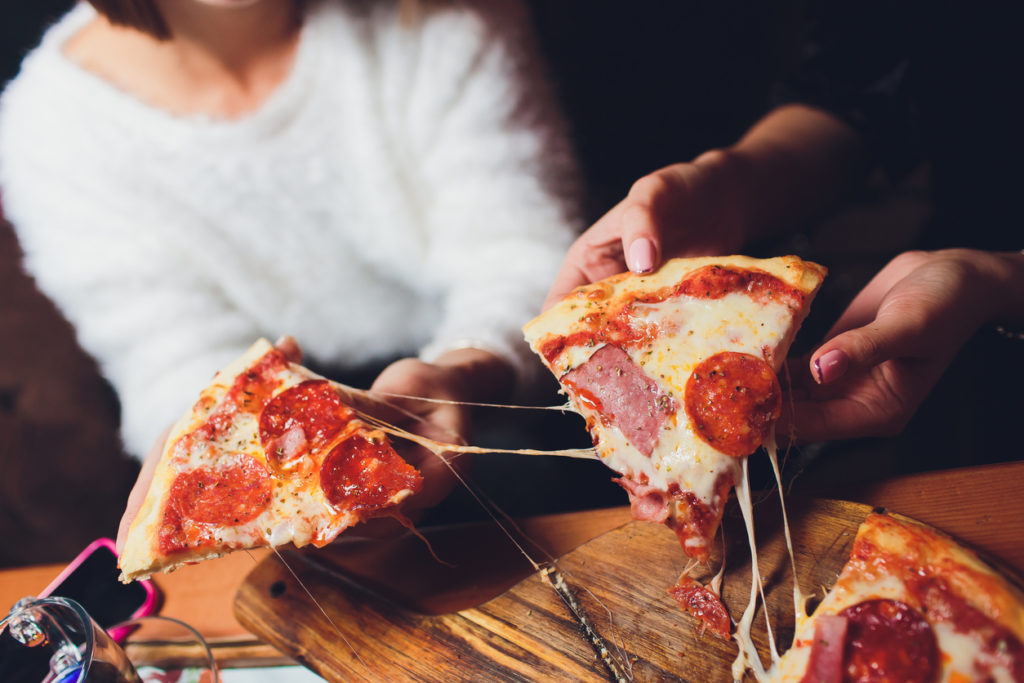 Friends eating pizza together