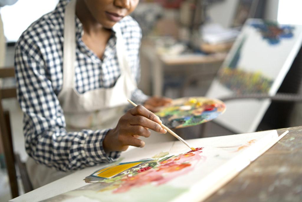 Female artist working in studio