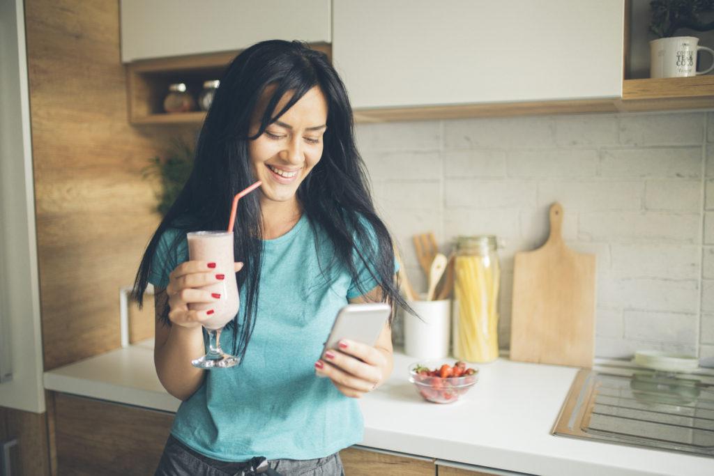 Woman enjoying a pink smoothie