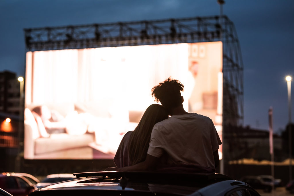 young couple at drive in movie
